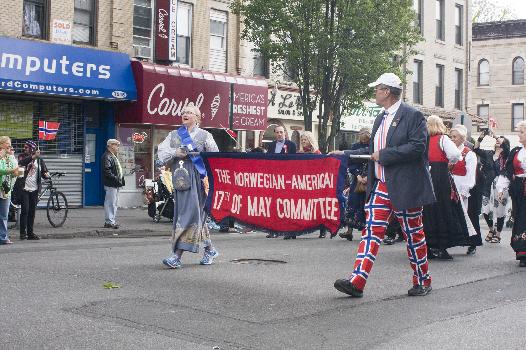 Leaders of The 17th of May Committee carry their banner through the parade. This group is responsible for planning and promoting the parade in Brooklyn each year.