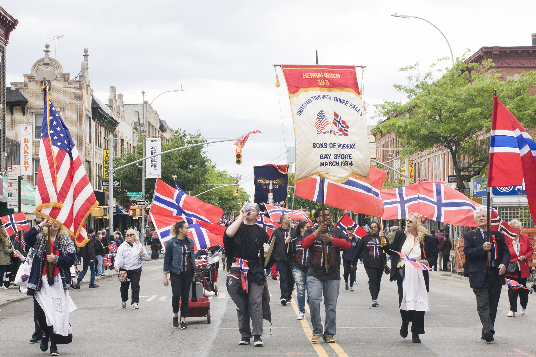The Sons of Norway Lodge from Islip, NY marches in the parade. Membership lodges for Norwegian Americans from all over the northeast march in the parade, some with distinct floats or banners.