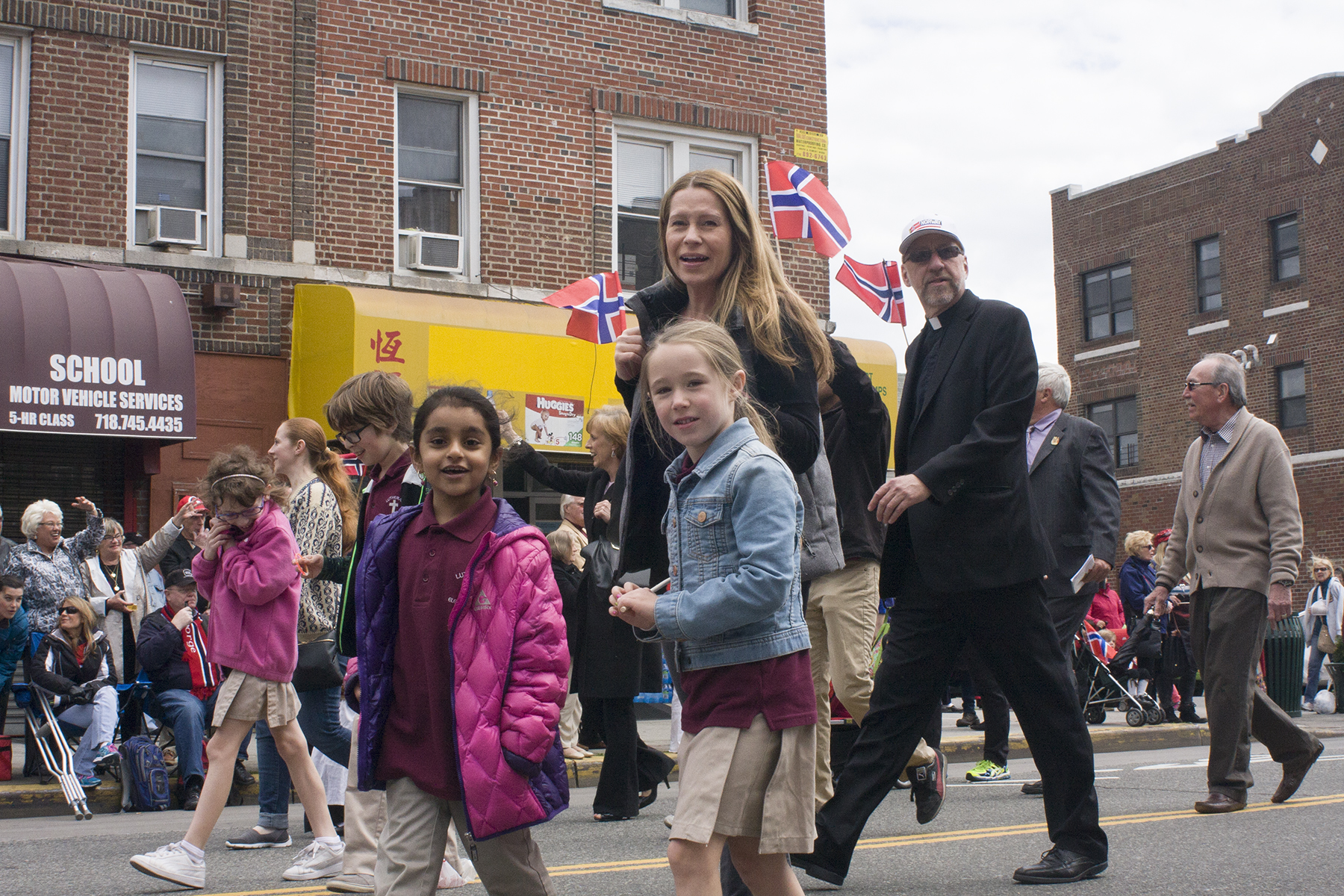 Girl Scouts from the local Bay Ridge troupe march together in the parade.