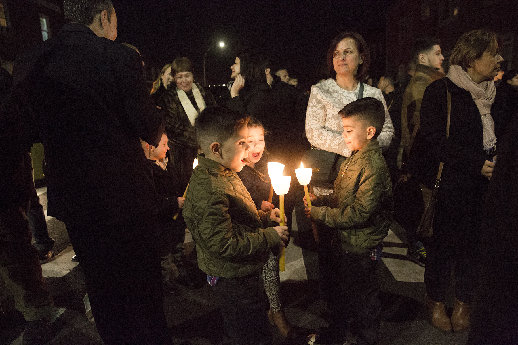April 14, 2017, three boys with candles on Good Friday