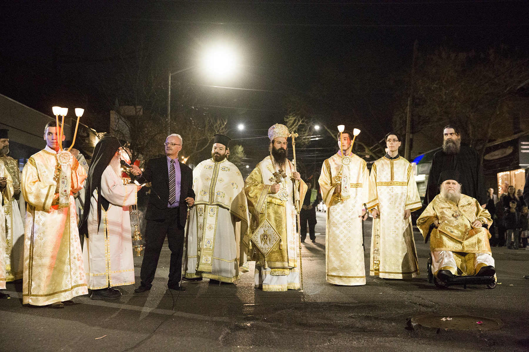 April 14, 2017. Priests stand while procession pauses at Ditmars Boulevard and 31st Street.