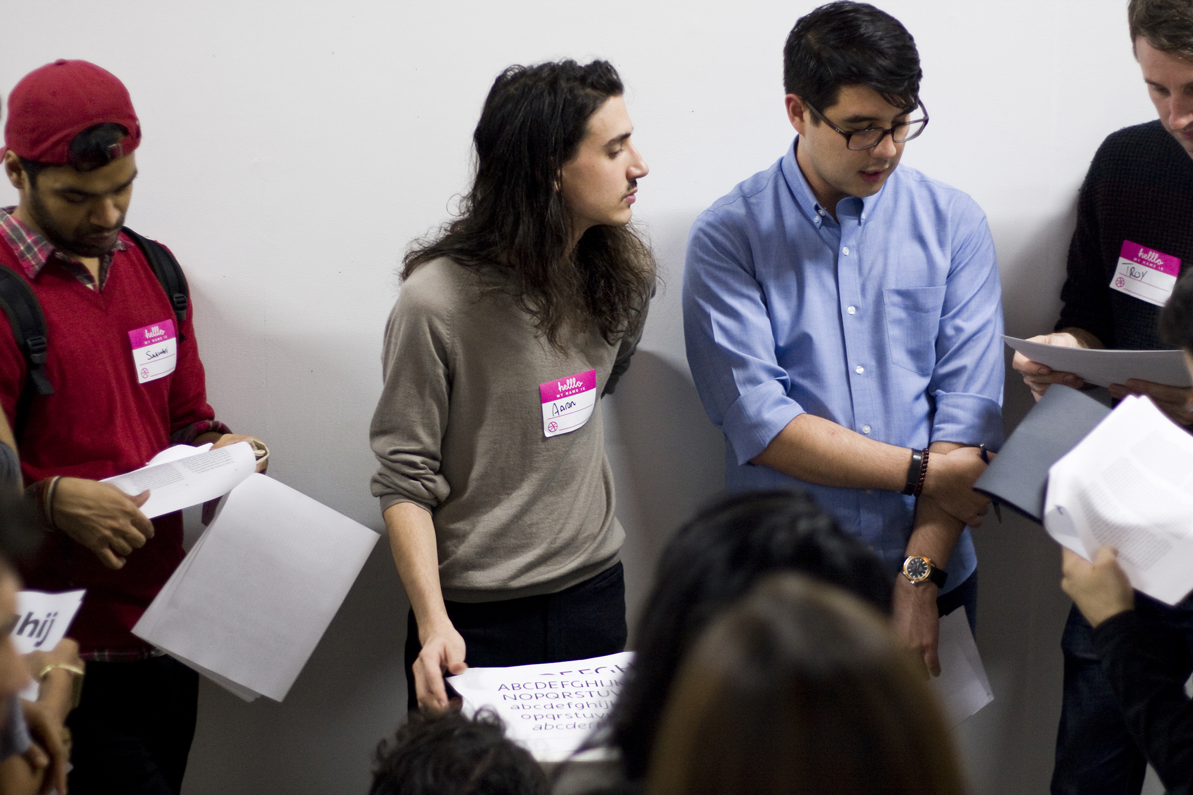 Aaron (center) listening to feedback on their project while the attendees look at their printed samples. November, 2015
