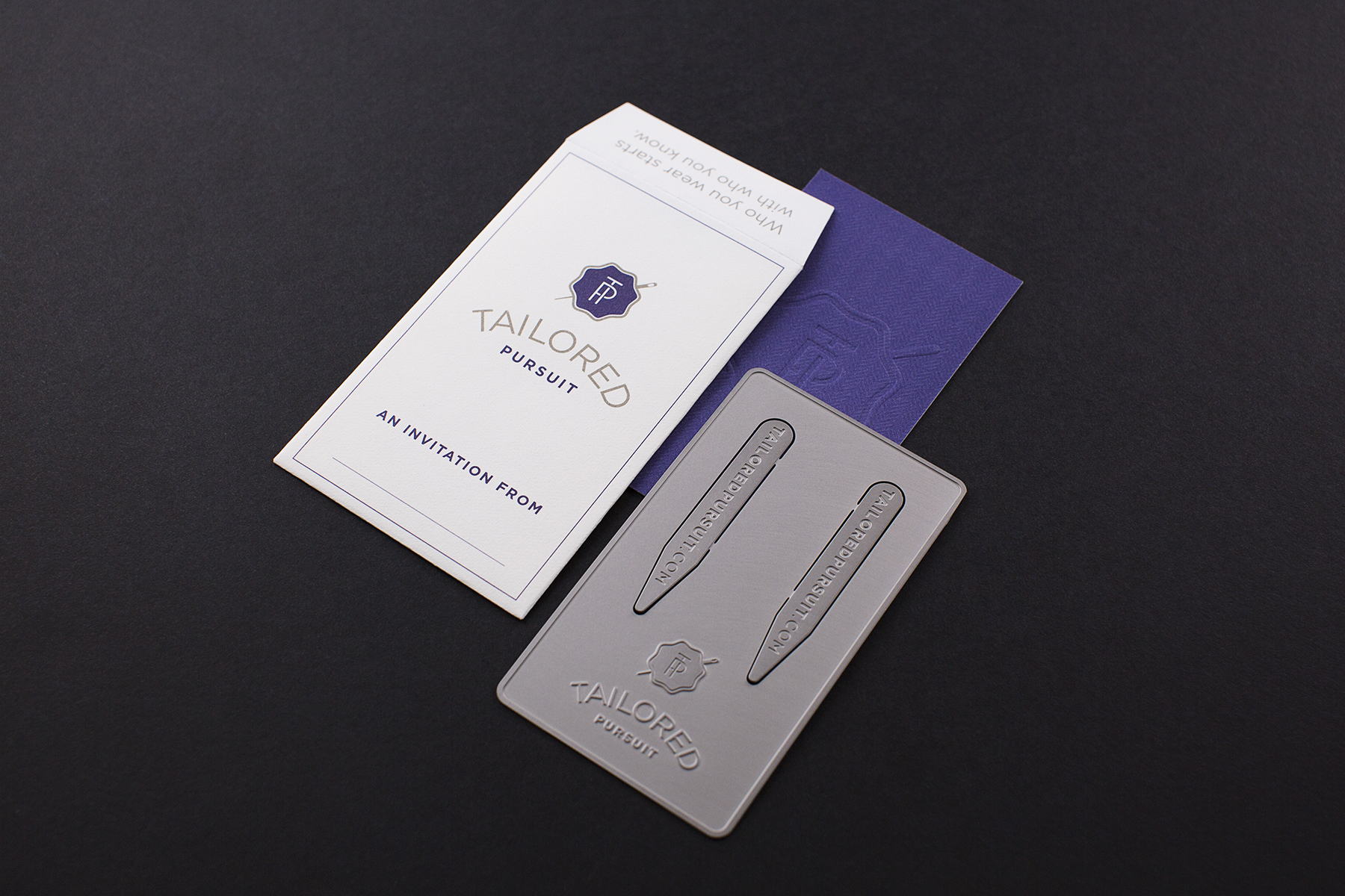 Tailored Pursuit asked for a promotional piece to hand out to potential members as an invitation. Here you see a business card as well as a set of collar stays made out of stainless steel.
