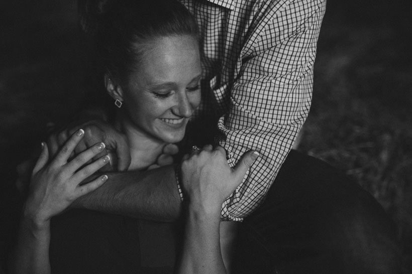 Erin and Scott huddle in the attic of a rustic barn