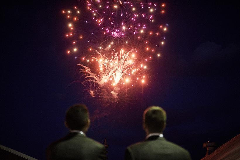 wedding fireworks light up the sky after a reception