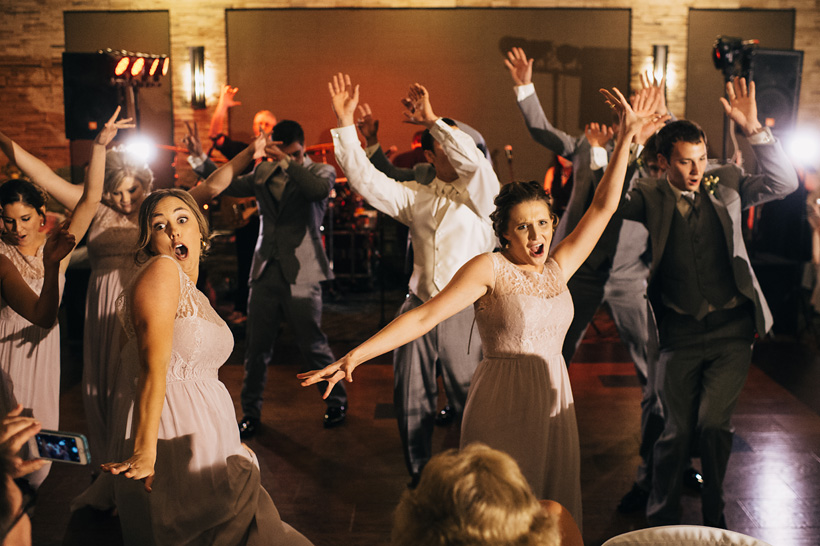 The wedding party performs a choreographed dance to Uptown Funk