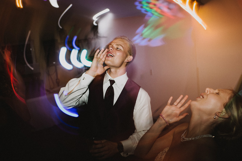 A dancing shot kicks up a notch thanks to crazy lighting as the bride's brother hollers out during a reception at Summerset Winery in Indianola