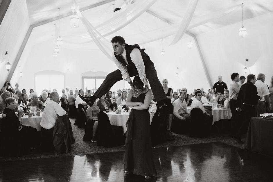 A groomsman and bridesmaid play leapfrog during a recent wedding