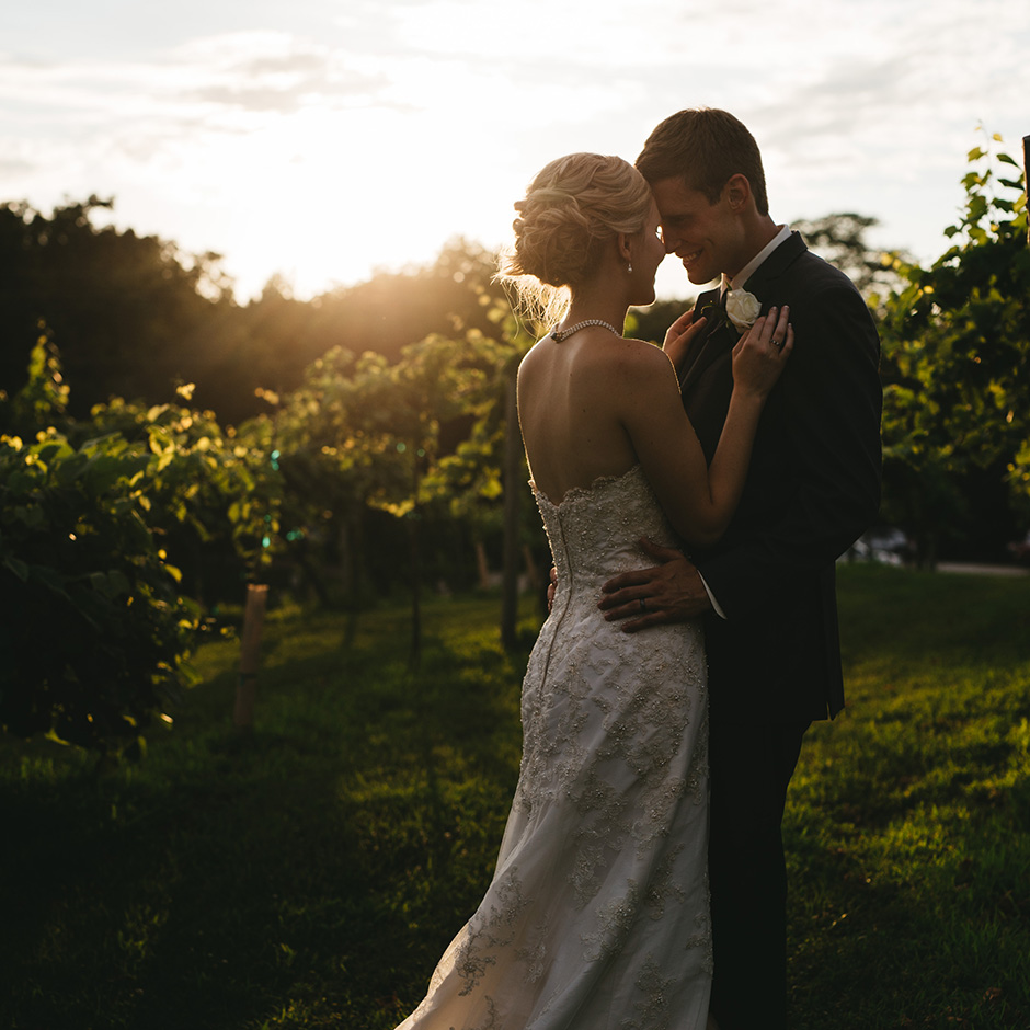 Emily and Josh hold each other as the sun goes down | Des Moines Wedding Photographer Brian Davis