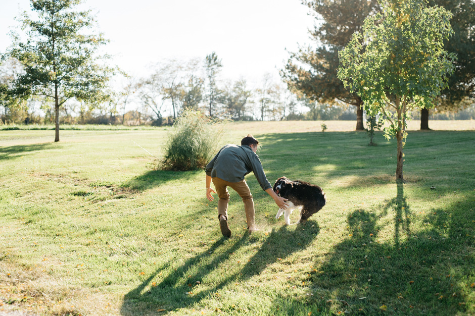 An energetic dog gets a little excited and gives her owner a playful little dog bite during the engagement
