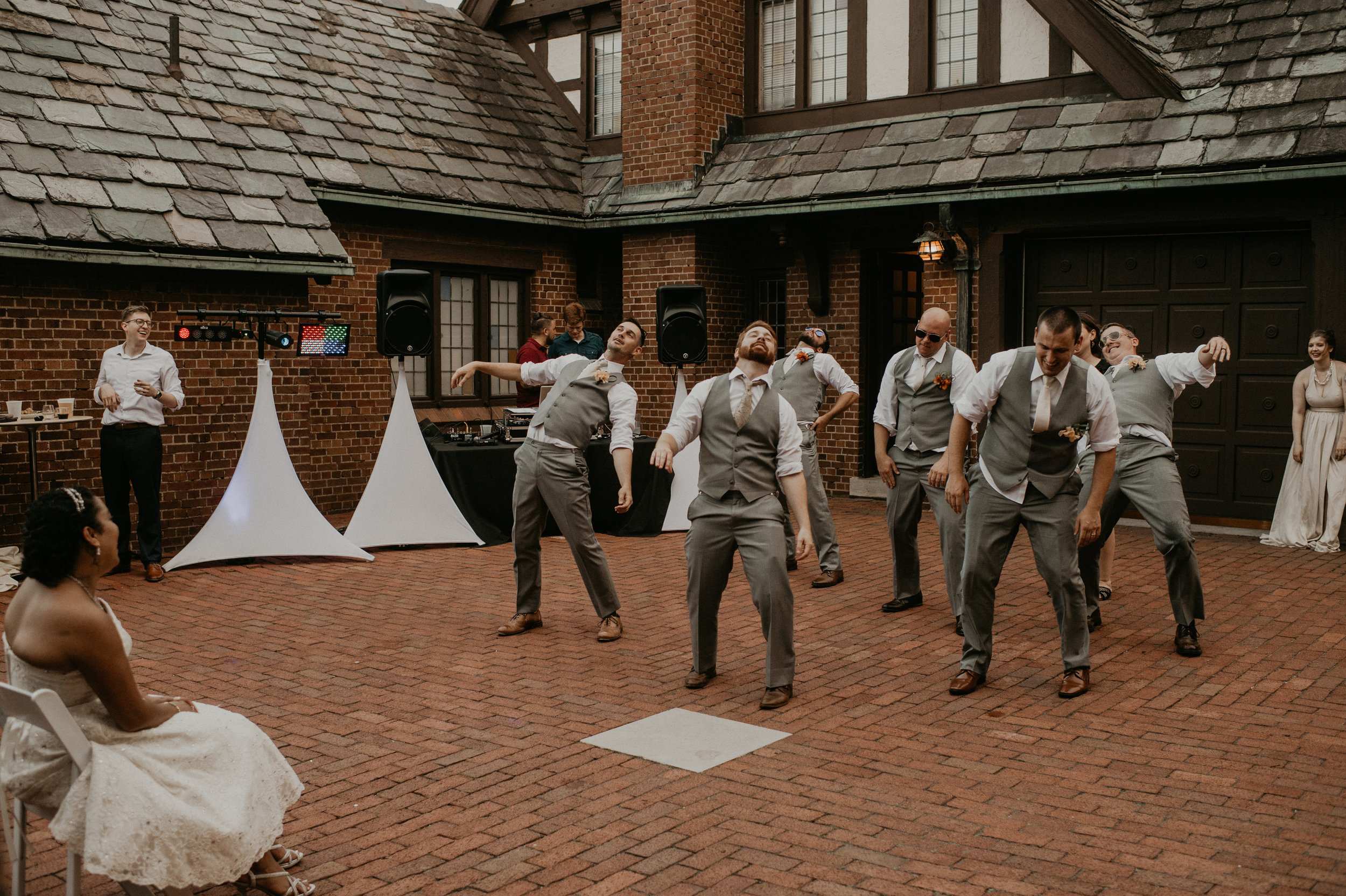 Groomsmen performing Thriller | Iowa Wedding Photographer Brian
