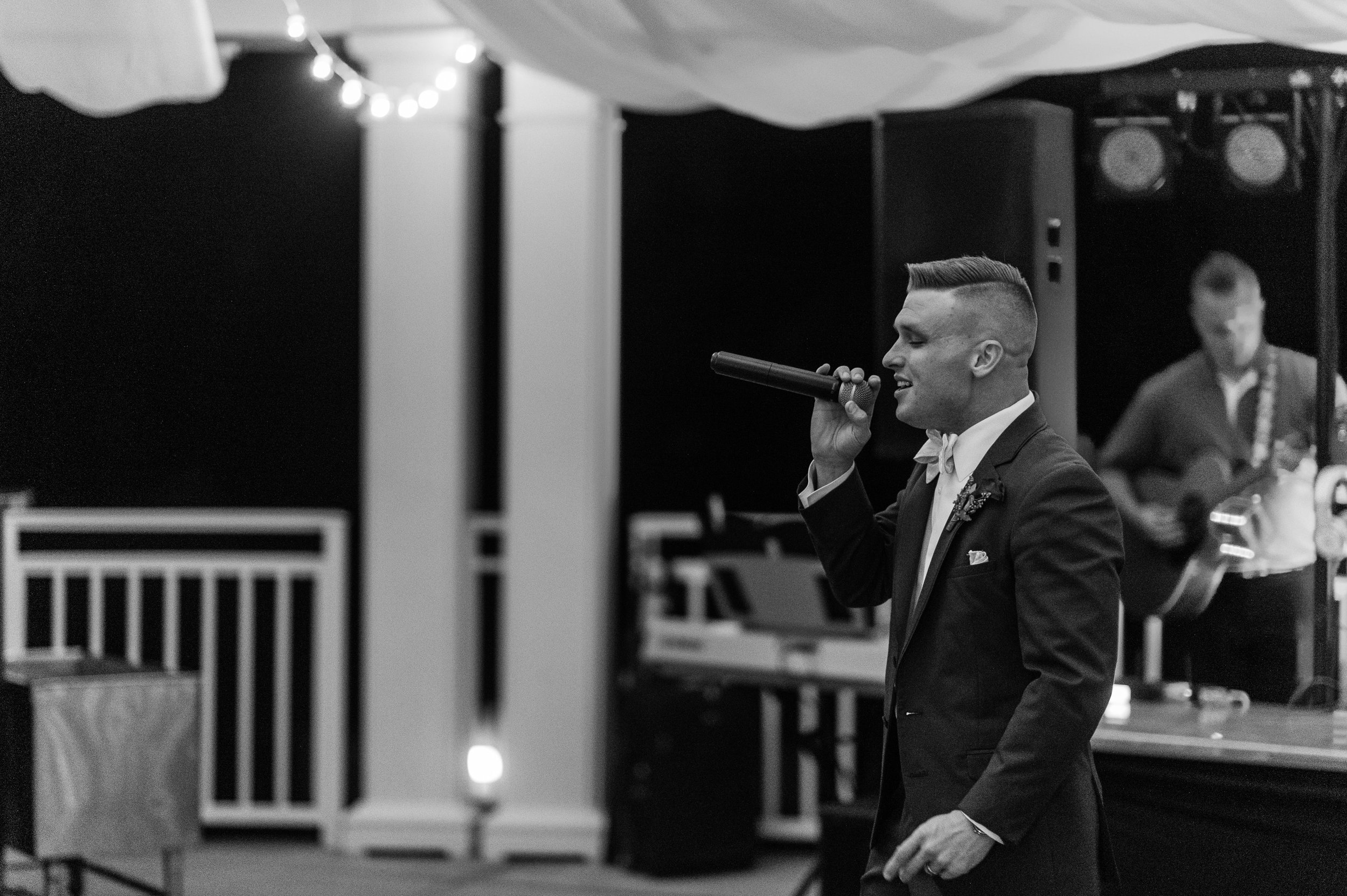 Sean singing for his beautiful bride at their wedding | Iowa Wed