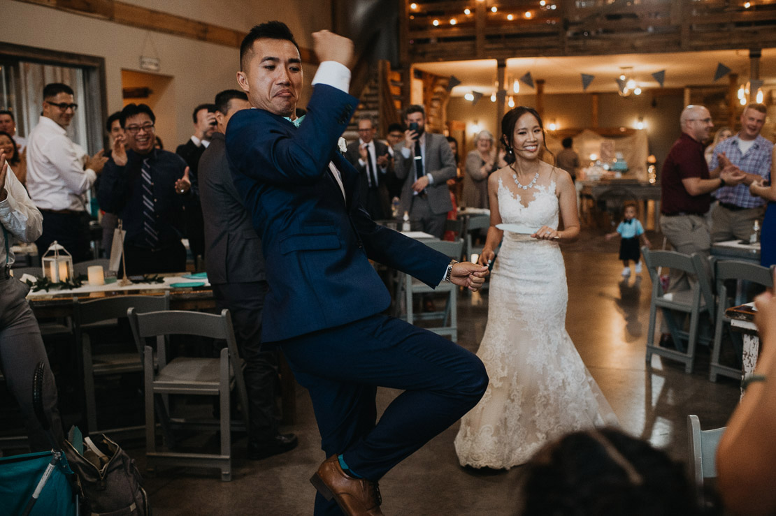 Thanh and Yome dabbed their grand intoduction | Iowa Wedding Pho