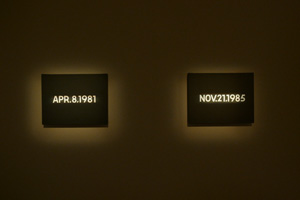 5 Temporal translations: 'Time of Others' at SAM: Chloe Wolifson,  Singapore    On Kawara,  APR. 8, 1981, 1981 , and  NOV. 21, 1985, 1985 , from the  Today  series, installation view, Singapore Art Museum, 2015–16; both acrylic on canvas, newspaper and paper box, 25.7 x 33.4cm, Museum of Contemporary Art Tokyo collection