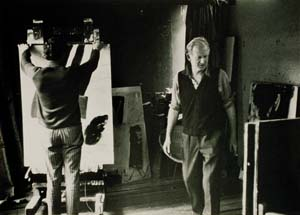 5 Drawing the mark: 50 years of Watters Gallery: GLENN BARKLEY   Frank Watters and Tony Tuckson in the artist's Wahroonga studio, choosing works for Tuckson's first solo exhibition at Watters Gallery, Sydney, 1970; image and photo courtesy Margaret Tuckson