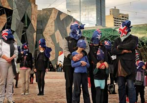 9 Two soliloquies in a rhythm: A conversation about curatorial collaboration: NATALIE KING AND DJON MUNDINE   boat-people,  Muffled Protest , 2010, documentation, Federation Square, Melbourne, dimensions variable; image courtesy the artists. photo: Tanja Milbourne