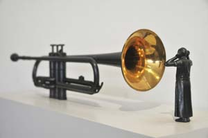 1 Biennale fever in Indonesia: temporary sites for contemporary, art: ROY VORAGEN   Agus Suwage,  Social Mirror #3 , 2013, trumpet, copper, wood and car audio systems, 118 x 24 x 70cm; image courtesy the artist