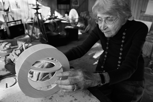 13 Inge King 1915 – 2016: Jane Eckett,  Melbourne    Inge King in her studio at Warrandyte, 2013, working on a balsa-wood maquette for the 'Celestial Rings' series; photo: Jacqui Henshaw