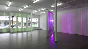 1 Straddling the spectrum: Rebecca Baumann and Brendan van Hek's 'colour restraint': Andrew Purvis   Rebecca Baumann,  Once More With Feeling , 2014, installation view, Trivision billboard, plexiglas, ETC Source Four, 330 x 430cm. image courtesy the artist; photo: Sam Harnettmore