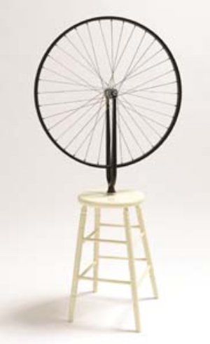 12 A Century of Readymades: MARK HOLSWORTH   Marcel Duchamp,  Bicycle wheel , 1913, reconstructed 1964, painted wooden stool and bicycle wheel; stool: 50.4 cm (h); wheel: 64.8cm (diam.); 126.5 cm (h) (overall); Collection: National Gallery of Australia, Canberra; © Succession Marcel Duchamp/ADAGP/Paris; licensed by Viscopy 2013