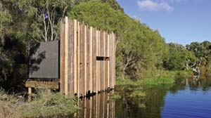 16 M12: Ornitarium BARBIE: GREENSHIELDS   Front view of M12's Ornitarium, 2011, local timbers, Wetlands Education Centre, Denmark, Western Australia. Image courtesy the artists. Photograph by M12