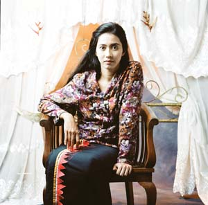 10 Beyond the Self: Contemporary portraiture from Indonesia & other near neighbours: CHRISTINE CLARK   Herra Pahlasari,  Potret diri di depan kelambu terbuka (Self-portrait before the   open mosquito net) , 2009, pigment print on Hahnemühle Leonardo canvas