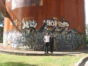 18 Remembering 'Humanity Lost': Karla Dickens and Aris Prabawa   Aris and Karla in front of their 'Appin Massacre' mural on the grounds of Casula Powerhouse Arts Centre, Sydney, 2010. Image courtesy Casula Powerhouse Arts Centre. The mural includes text from an account ofthe massacre: 'The dogs sounded the alarm and the natives fell over cliff; it was moonlight'