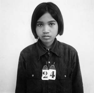 17 A Tale of Two Biennales: Gwangju and Busan: EN YOUNG AHN    An unidentified Prisoner, S-21 Prison , Phnom Penh, Cambodia, from Tuol Sleng Prison Photographs, 1975-1979. © Doug Niven and Tuol Sleng Museum of Genocide, Cambodia. Image courtesy Doug Niven