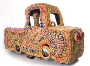 5 ReCoil: a Celebration of Fibre Art in Australia: CHRISTIANE KELLER   Kantjupayi Benson,  Truck and Driver,  2007, grass, raffia, string, wool, wire, mesh, wheels, 112 x 190 x 75cm. Courtesy the artist and Tjanpi Desert Weavers