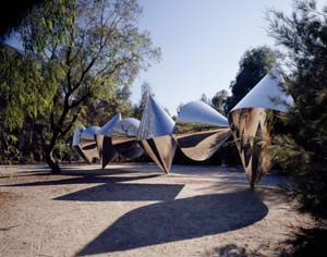 9 Shapes of purity & reality: an interview with Bert Flugelman: JAN JONES   Bert Flugelman,  Cones , 1982, stainless steel, 450 x 2050 x 450cm. Installation view, National Gallery of Australia Sculpture Garden. Collection: National Gallery of Australia, Canberra. Commissioned 1976, purchased 1982. © Bert Flugelman