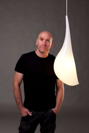 11 Robert Foster 1962 – 2016: Anne Brennan,  Canberra    Robert Foster with his F!NK Droplet Hanging Light, 2011; thermoformed acrylic, electrical components, ceiling plate, 60 x 3cm; image courtesy the estate of the artist