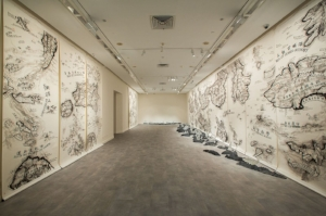 9 A multilayered mapping: The 5th Singapore Biennale: Tarun Nagesh,  Singapore    Qiu Zhijie,  One Has to Wander through All the Outer Worlds to Reach the Innermost Shrine at the End , 2016, installation view, 5th Singapore Biennale, 2016; ink on paper, glass and stone, dimensions variable; collection of the artist, Singapore Biennale 2016 commission; image courtesy the artist and Singapore Art Museum