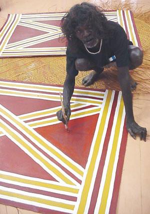 4 Two quiet men: Micky Garrawurra c 1940–2006 and Tom Djumburpur 1920–2006: DJON MUNDINE   Micky Garrawurra painting. © Bula'bula Arts 2006