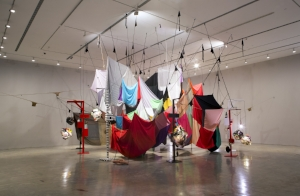 1 Dispatches: Andrew Stephens   Mikala Dwyer,  Square Cloud Compound , 2010, Installation View, Musuem of Contemporary Art, Sydney; Fabric stockings, glass, beer, Champagne, Plastic, Ceramics, Found Things, Wood, Rocks, Lights, Paints, Acrylic, Cat and Bird ornaments, dimensions variable; image courtesy the artist; photo: Jessica MAurer
