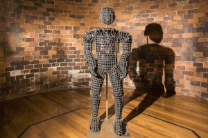 8 PENNY BYRNE: ARMED AND VULNERABLE: ARJMAND AZIZ   Penny Byrne,  Hurt Locker , 2015, installation views,'Hearts and Minds', Canberra Glassworks, 2018; Murano glass, mild steel, 200 x 80 x 50cm;images courtesy Canberra Glassworks; photos: Sam Cooper