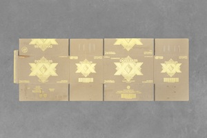 2 notes from the field: Chloé Wolifson   danh vo,  dos xx ambar,  2016, dos xx ambar beer box found in mexico city, gilded in thailand, 50 x 140cm; image courtesy the artist, arndt art agency (a3), berlin, and kurimanzutto, mexico city