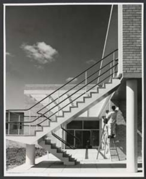 12 Remembering Tomorrow, As Modern as Tomorrow: Photographers in Postwar Melbourne: CHRISTOPHER HEATHCOTE   Helmut Newton,  Workmen putting the finishing touches to rear of amenities block , c. 1951–54, gelatin silver photograph, gift of the Shell Company of Australia, 2005