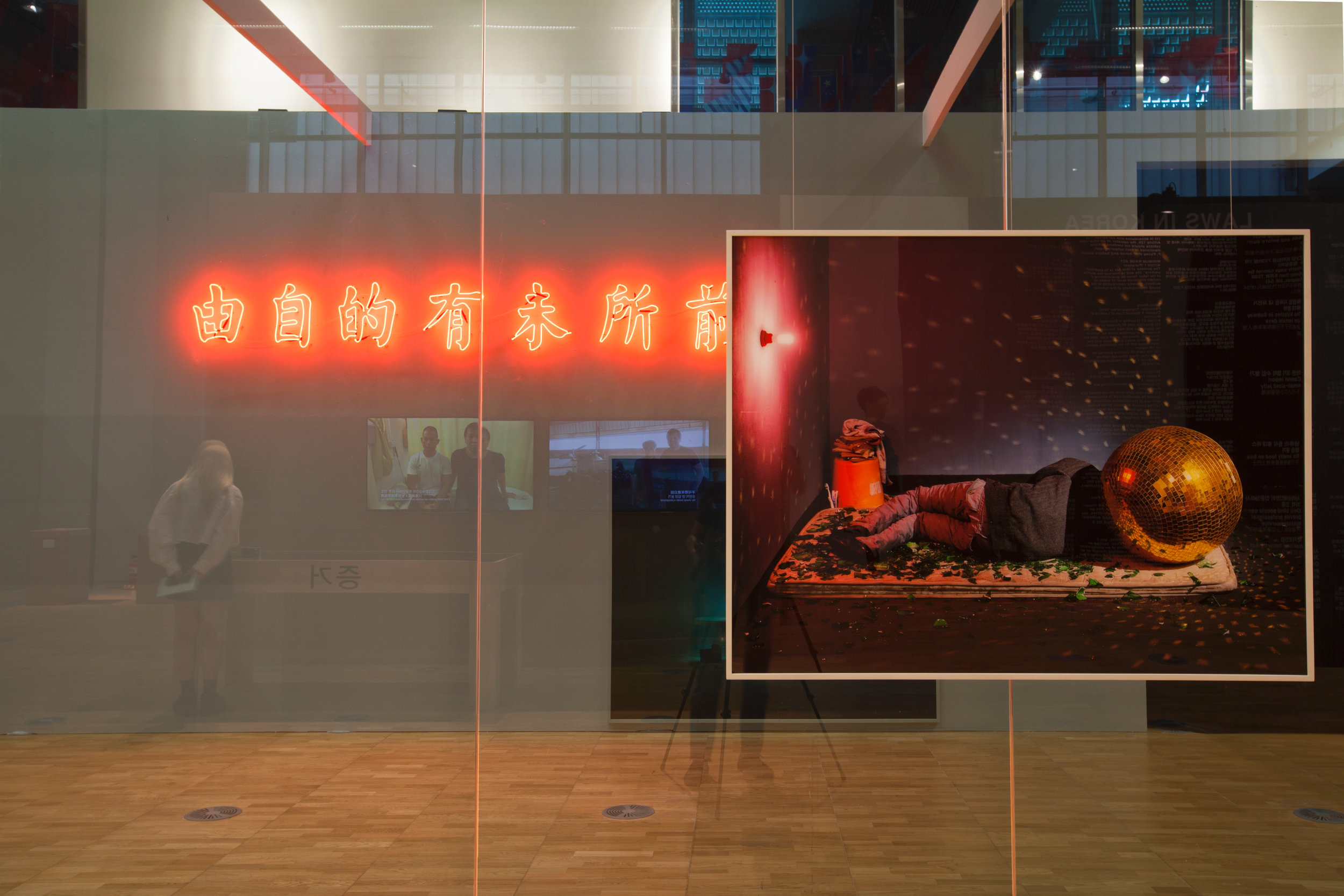 Chen Wei,  New City/History of Enchantment – Tunnel , 2010–18, mixed-media installation: neon lights, inkjet prints, light box, LED display module, prints, dimensions variable; image courtesy the artist and ShanghART Gallery, Beijing, Singapore and Shanghai