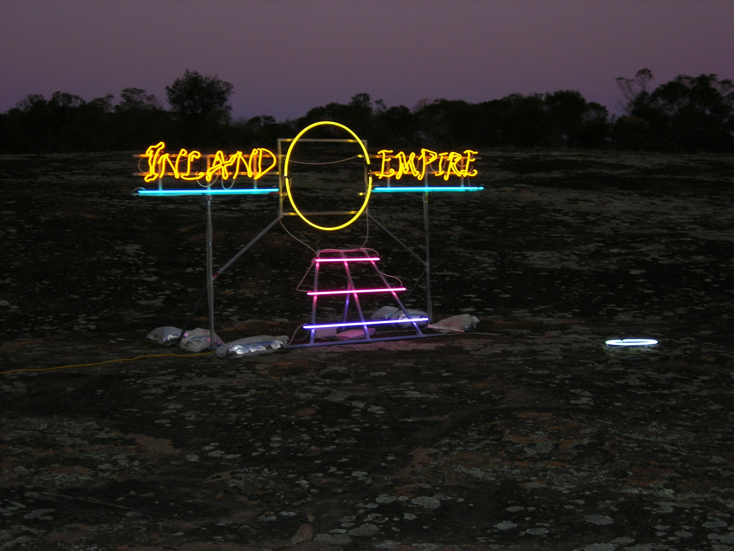 7 janet burchill and jennifer mccamley; culture jamming at heide: sophie Knezic,  melbourne    Janet Burchill and Jennifer McCamley,  Inland Empire , 2008, installation view, Kellerberrin, Western Australia, 2008; neon tubing, electrical components, scaffolding, dimensions variable; image courtesy the artists and Neon Parc, Melbourne; © the artists