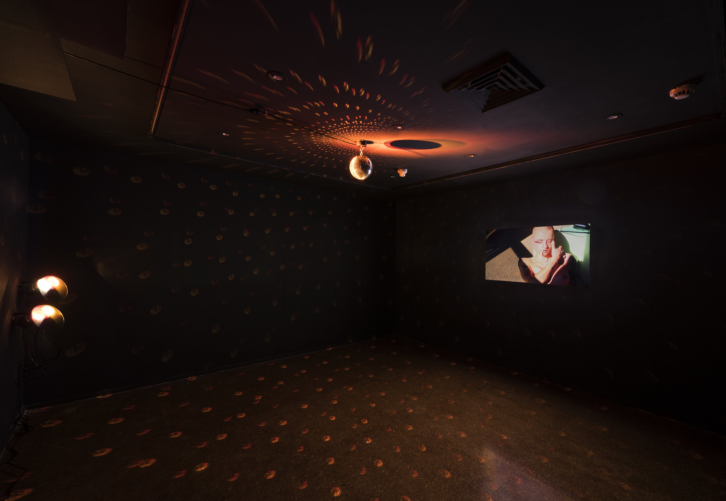 Jordana Bragg,  Enthusiastic Valentine,  2019, installation view, 'Tainted Love', Canberra Contemporary Art Space (CCAS), 2019; HD video, mirror ball and disco lighting, 3:30 mins duration; courtesy the artist and CCAS, Canberra; photo: Brenton McGeachie