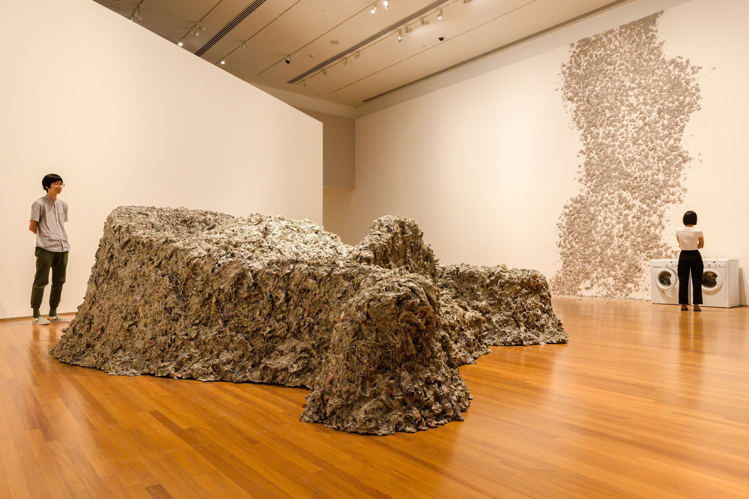 3 awakening unheard voices: Alex burchmore,  singapore    Huang Yong Ping,  Reptiles , 1989/2013, installation view, 'Awakenings', National Gallery Singapore, 2019; paper pulp, iron and washing machine, 495 x 1300 x 900cm; M+, Hong Kong; image courtesy National Gallery Singapore