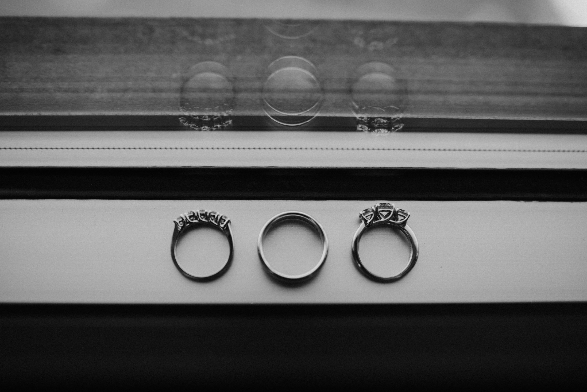 Close up details of wedding bands near a window