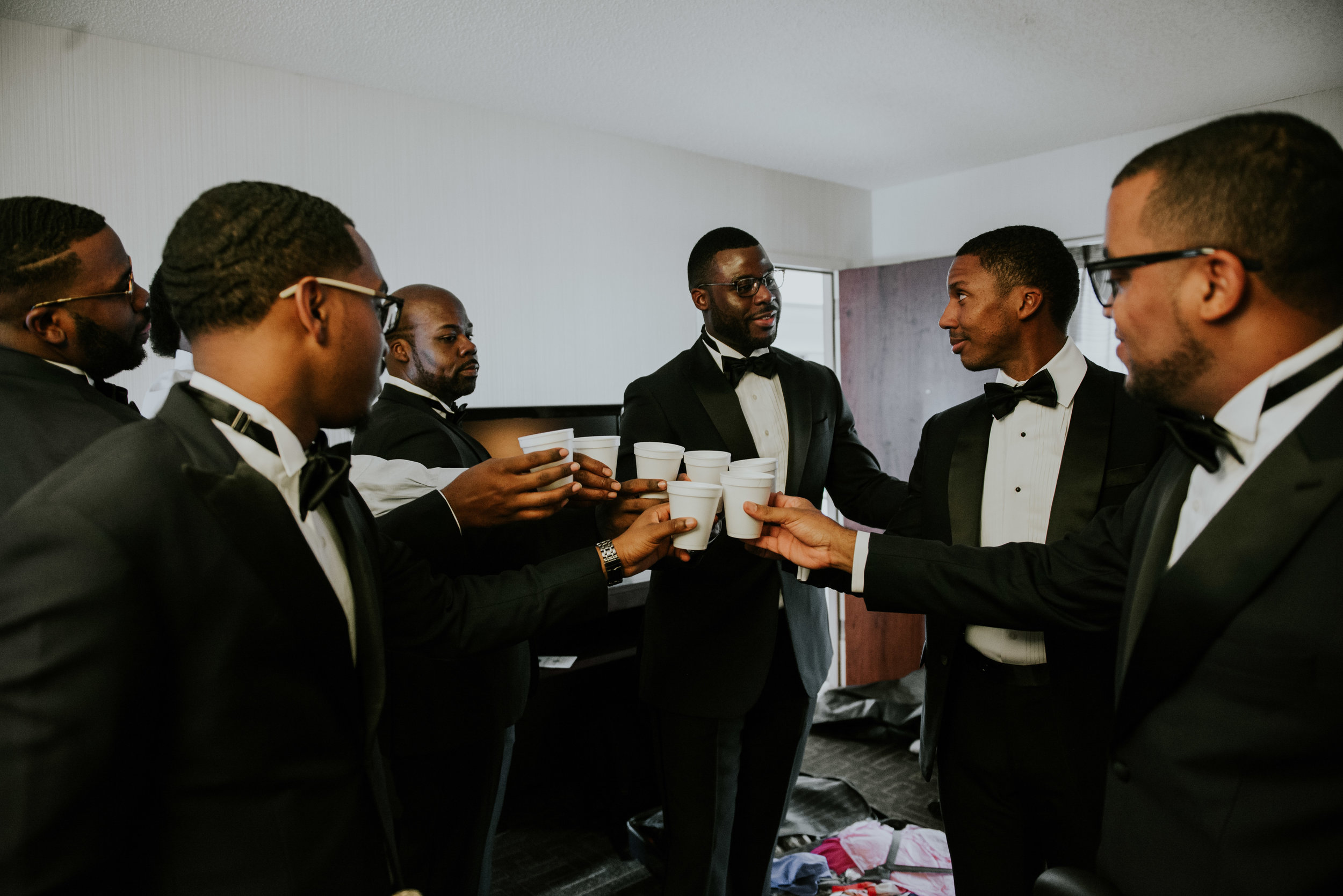 Groomsmen toasting to groom before wedding ceremony