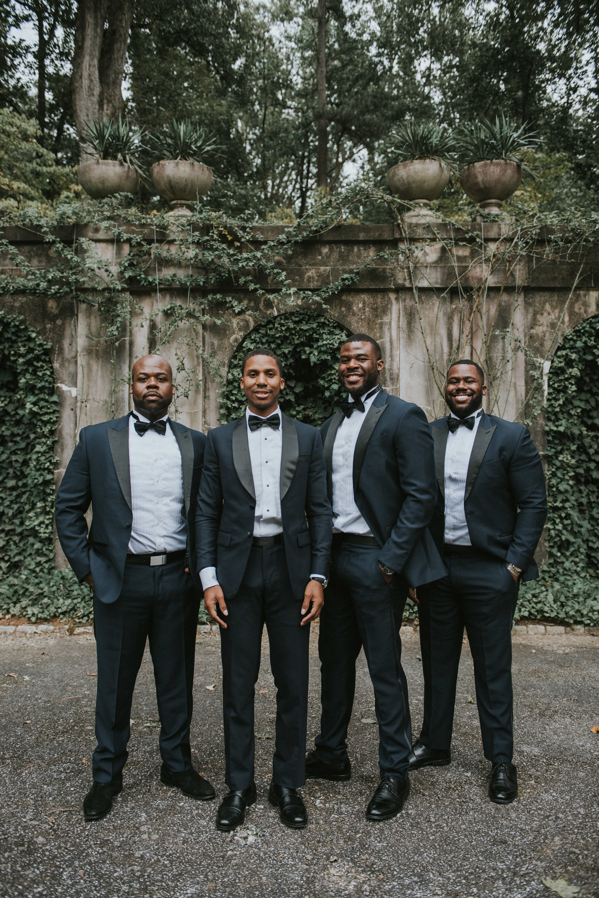 Groom and groomsmen in navy Indochino tuxedos at Swan House in Atlanta, GA
