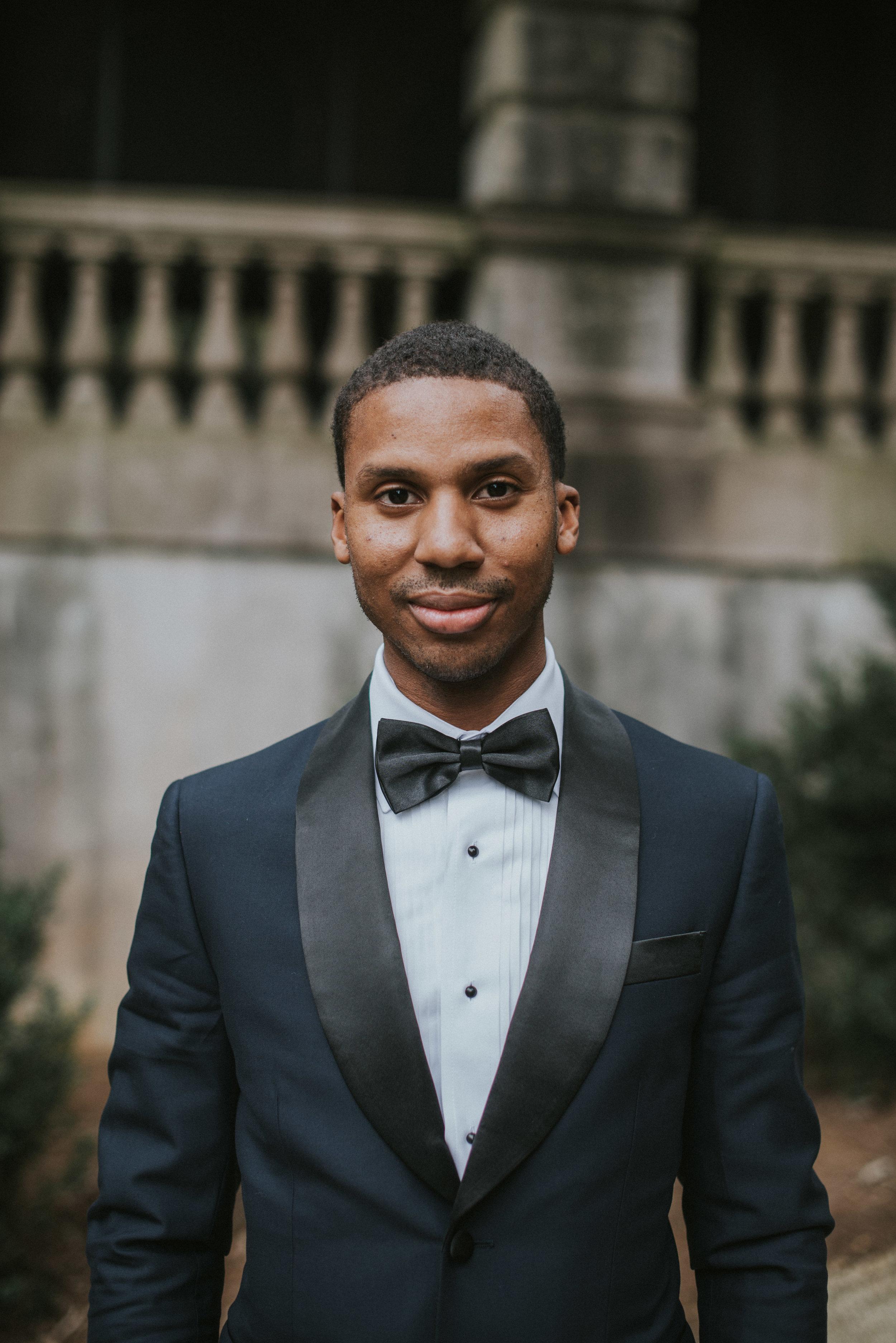 Portrait of groom in navy Indochino tuxedo