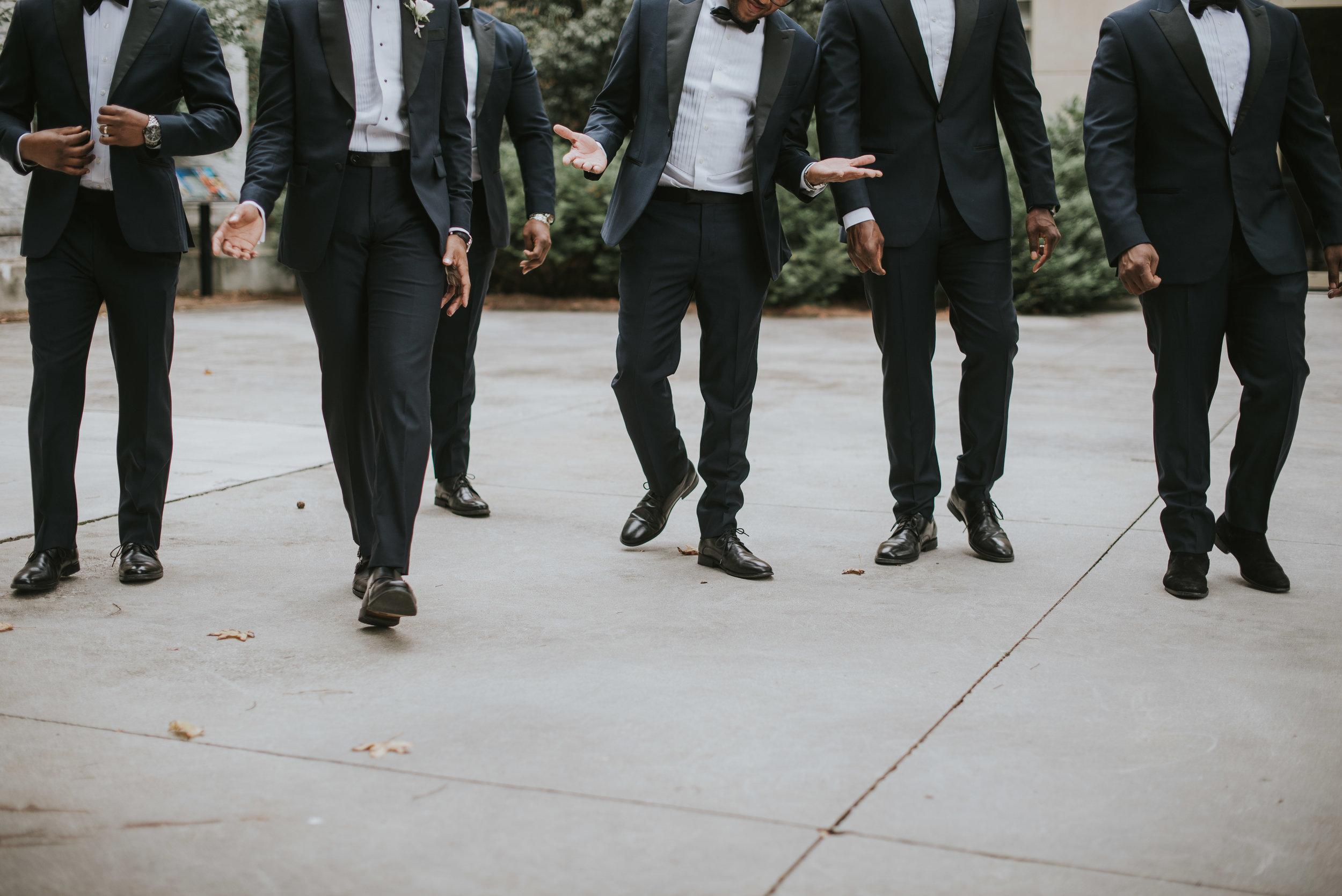 Groomsmen walking in navy Indochino tuxedos
