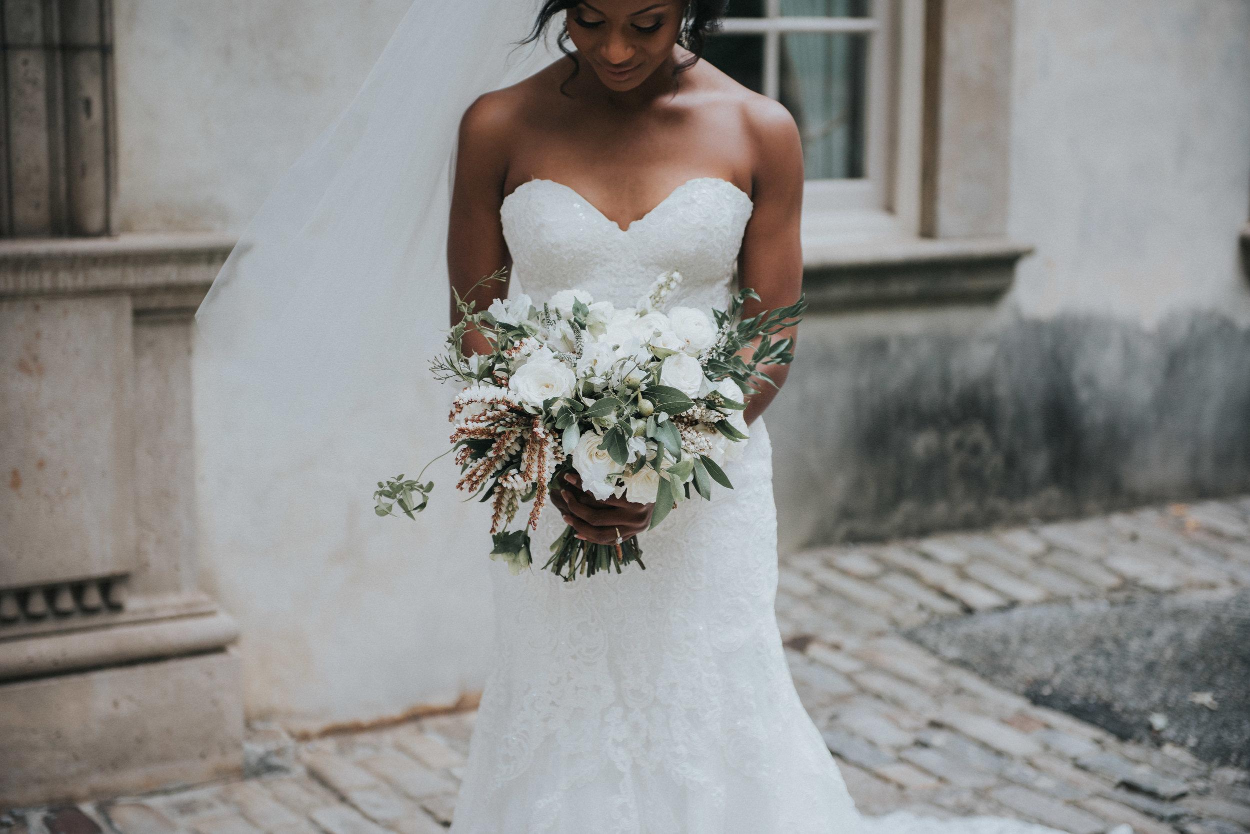 Bride holding eucalyptus bouquet at Swan House in Atlanta, GA