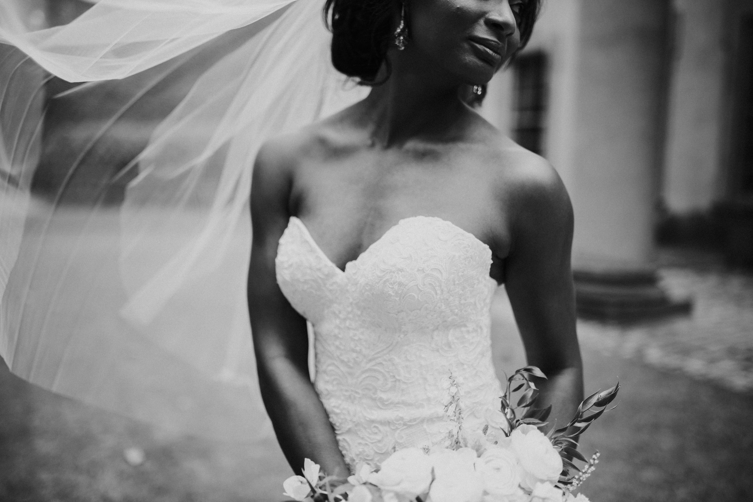 Details of bride in Martina Liana wedding gown and veil