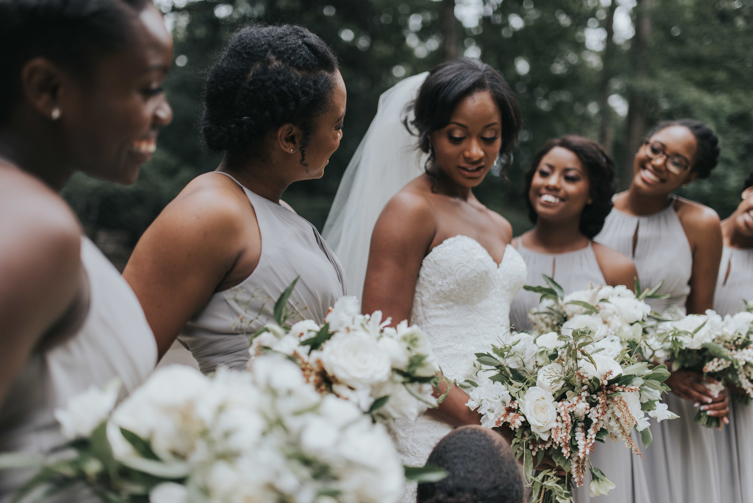 Bridesmaids in gray wedding dresses with eucalyptus bouquet