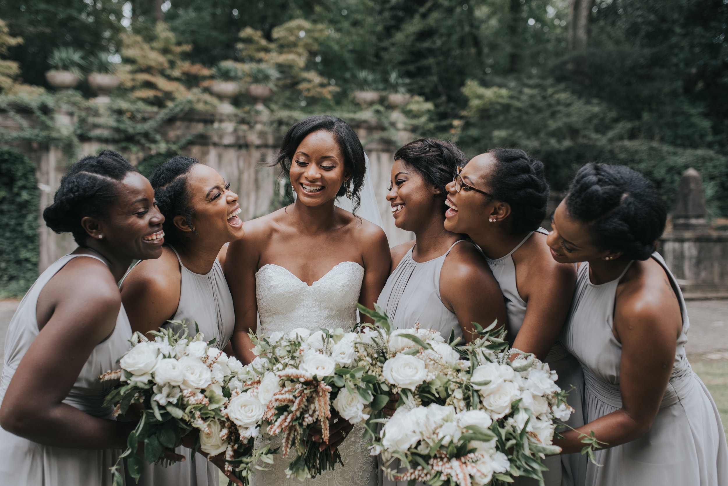 Bridesmaids in gray wedding gowns and eucalyptus bouquets